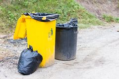 Yellow trash on the street. Stock Image