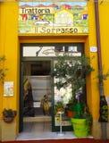 Yellow Trattoria. Trattoria (Restaurant) with colourful façade and picturesque decoration , Ferrara, Italy stock photos