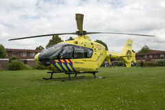 Yellow trauma helicopter in Holland Stock Image