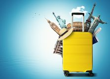 Yellow travel bag with world landmark stock image