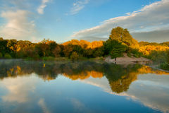 Yellow trees reflection in water Royalty Free Stock Photos