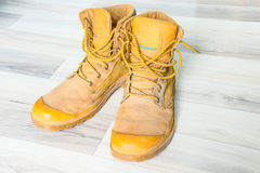 Yellow trekking boot shoes Stock Images