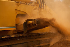 Yellow trencher machine working Stock Image