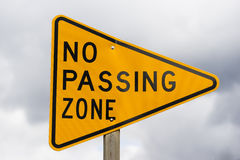 Yellow Triangle Road Sign Warning No Passing Zone Stock Photography