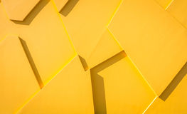 Yellow triangles wall background Royalty Free Stock Photography