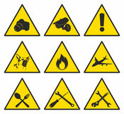 Yellow triangular signs. Yellow and black triangular signs Stock Images