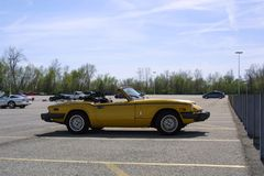 Auto Course St. Charles Family Arena Missouri. 1980 yellow Triumph spitfire he auto is a monthly event during the summer top down in parking lot stock photography
