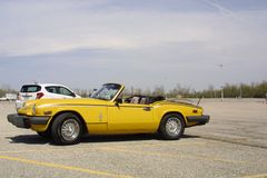 Auto Course St. Charles Family Arena Missouri. 1980 yellow Triumph spitfire he auto is a monthly event during the summer top down in parking lot royalty free stock photos