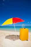 Yellow trolley under the sunshade Royalty Free Stock Photos