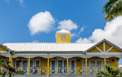 Yellow Tropical Home with Tin Roor Royalty Free Stock Image