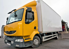 Yellow truck. For transportation of different types of goods Stock Photo