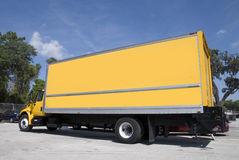 Yellow Truck. A yellow box delivery truck with blue sky Royalty Free Stock Photography