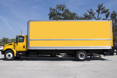 Yellow Truck. A yellow box delivery truck with blue sky Stock Image