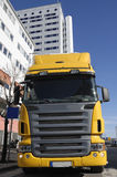 Yellow truck in business area Royalty Free Stock Images
