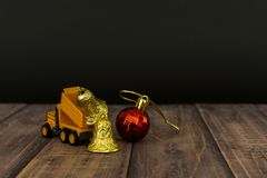 Yellow truck car mini moving christmas ball for Christmas Decoration. With copy space royalty free stock photography