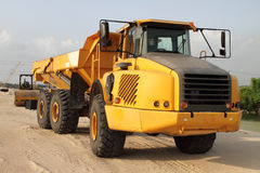 Yellow truck on construction site Stock Photos