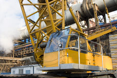 Yellow truck crane. Over scaffolding and blue sky Stock Photo