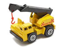 Yellow truck crane. Yellow truck with crane toy, isolated on white Royalty Free Stock Photo