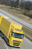 Yellow truck-driving, close-up Royalty Free Stock Photography