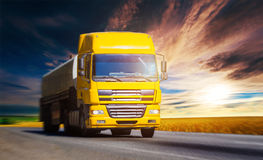 Yellow truck on highway Stock Images