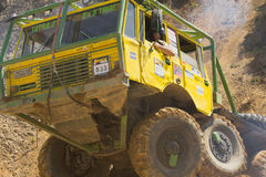 Yellow truck leaves a steep hill. Royalty Free Stock Images