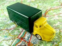 Yellow truck on a map Stock Images