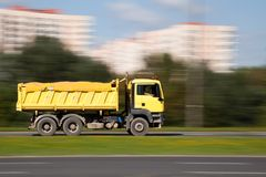 Yellow truck in motion blur Royalty Free Stock Images