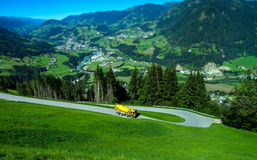 Yellow truck on mountain road tilt-shift view Royalty Free Stock Photography