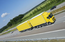 Yellow truck on the move Stock Images