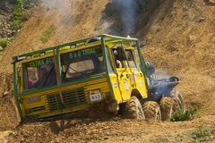Yellow truck is ready to leave a steep hill. Royalty Free Stock Photo
