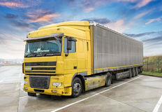 Yellow truck on road. Cargo transportation Stock Photography