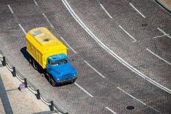Yellow truck on the road royalty free stock images