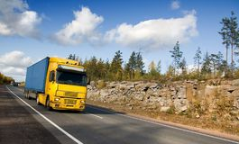 yellow truck on rocky highway Royalty Free Stock Photos
