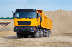 Yellow truck in the sand quarry Royalty Free Stock Image