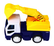 Yellow truck with a scraper to lift cargo Royalty Free Stock Photos