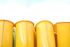 Yellow tubes. Yellow iron tubes in the city landscape royalty free stock photos