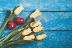 Yellow tulips on a blue wooden rustic table Royalty Free Stock Photography
