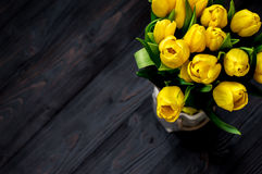 Yellow tulips. Bouquet of yellow tulips. Dark background Royalty Free Stock Photo