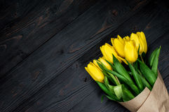Yellow tulips. Bouquet of yellow tulips. Dark background Royalty Free Stock Image