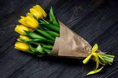 Yellow tulips. Bouquet of yellow tulips. Dark background Stock Photos