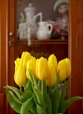 Yellow tulips in front of the dresser royalty free stock images