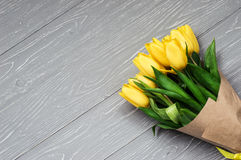 Yellow tulips. Bouquet of yellow tulips. Gray background Royalty Free Stock Image