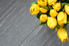 Yellow tulips. Bouquet of yellow tulips. Gray background Stock Photo