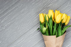 Yellow tulips. Bouquet of yellow tulips. Gray background Royalty Free Stock Photography