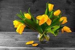 Yellow tulips bouquet. Vintage toned photo stock photos