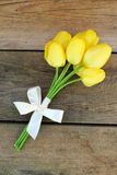 Yellow tulips and bow Royalty Free Stock Photography