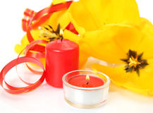 Yellow tulips and candles Stock Photography