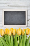 Yellow tulips with chalkboard Royalty Free Stock Photography