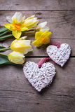 Yellow tulips and daffodils flowers  and decorative hearts on vi Stock Photos