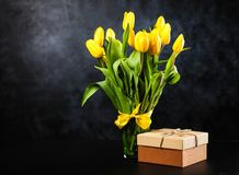 Yellow tulips on dark background. Yellow tulips on dark wall background Royalty Free Stock Images